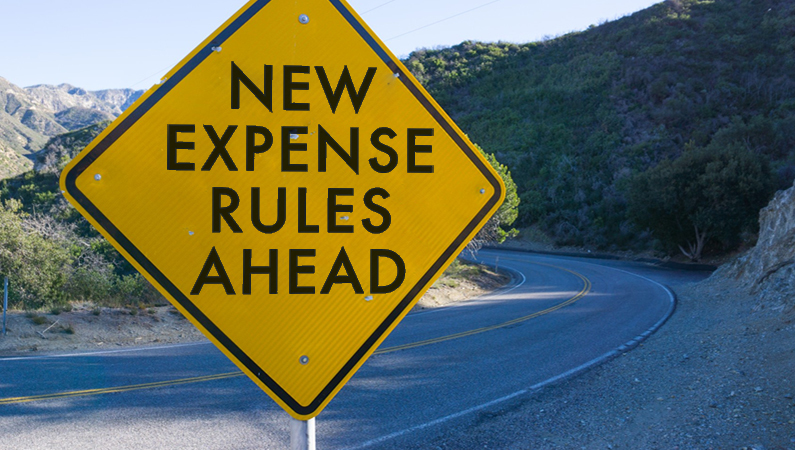 "Road sign with the words ""new expense rules ahead"""